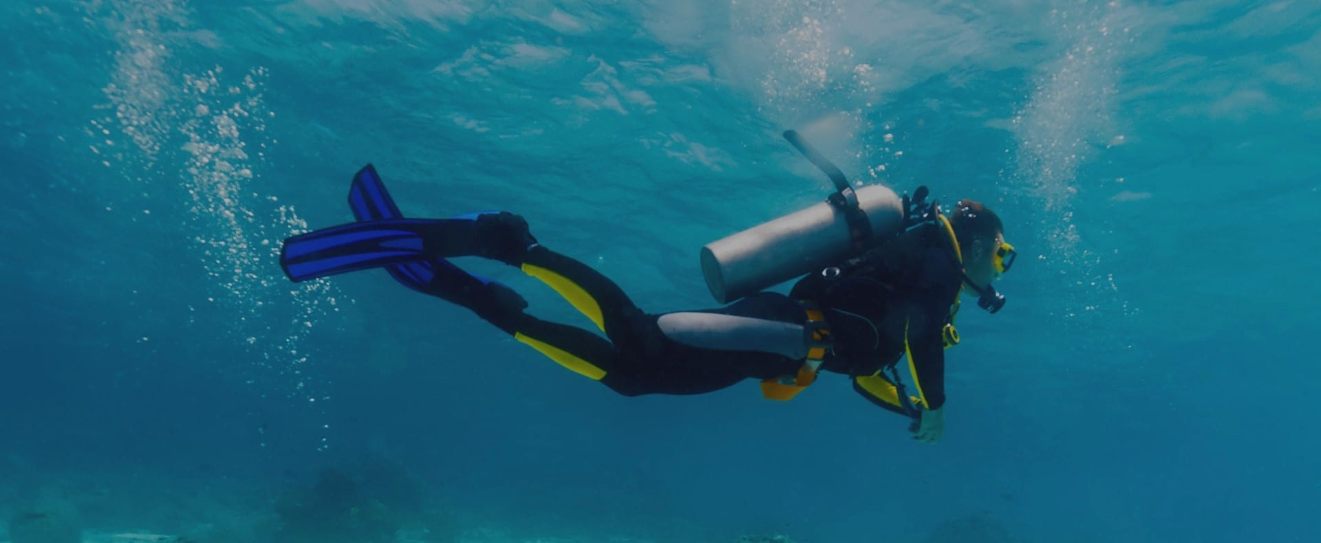 Diver in clear blue water